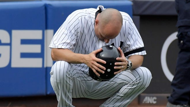 New York Yankees third base coach Joe Espada reacts after a young girl was hit by a line drive during the fifth inning of a baseball game against the Minnesota Twins on Wednesday at Yankee Stadium in New York.