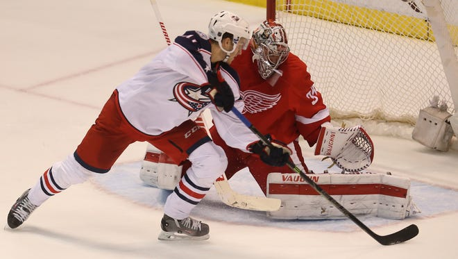 Red Wings goalie Petr Mrazek stops the Blue Jackets' Alexander Wennberg during the shoot-out of the Wings' win Tuesday at Joe Louis Arena.
