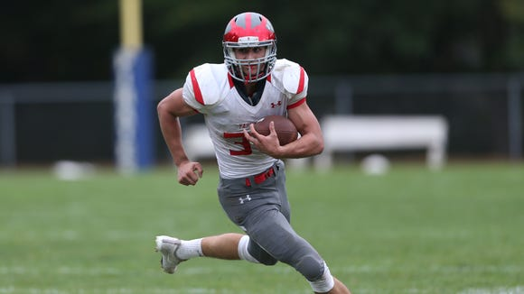 Tappan Zee's Garrett Sullivan (34) catches a pass during