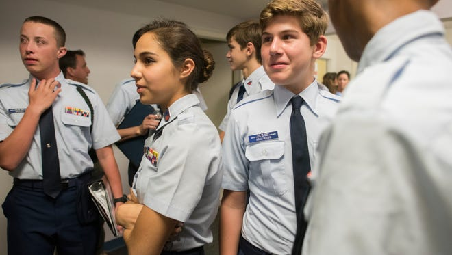 Cadets Stephen Havens, from left, Sapphire Gibson and Alden Kaufmann talk after a change of command ceremony at the Naples Civil Air Patrol on Monday night, Aug. 22, 2016.