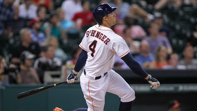 Houston Astros right fielder George Springer hits a home run during the seventh inning against the Baltimore Orioles at Minute Maid Park.