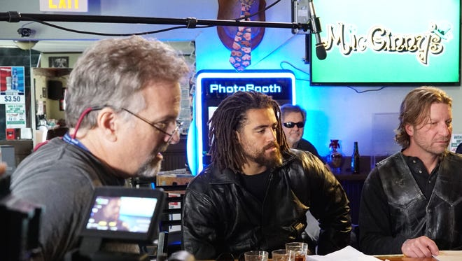 "Lebanon native and professional football player Jared Odrick (center) on the set of the movie ""Filling In"" with director Bradley Hawkins (left) and co-star Karl Holtz (right)."