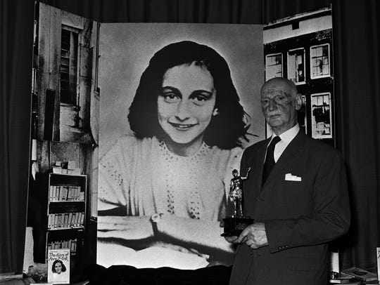 Dr. Otto Frank holds an award in 1971 for the sale