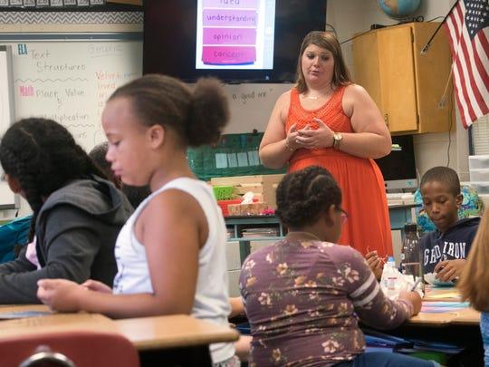 Heather MacDonald, a fifth-grade teacher at Pleasant Grove Elementary School, instructs her class on Thursday, Aug. 17, 2017.