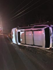 A car carrier overturned Saturday night on a camp connecting