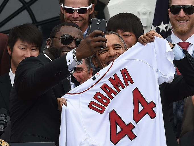 Red Sox designated hitter David Ortiz takes a selfie with U.S. president Barack Obama after presenting his jersey during a ceremony honoring the 2013 World Series champions.