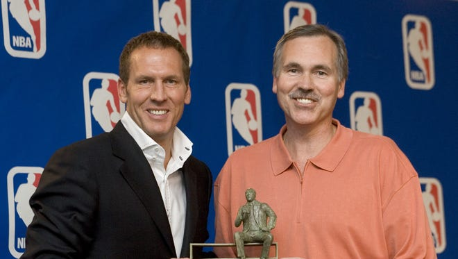 Phoenix Suns head coach Mike D'Antoni is presented the Red Auerbach Trophy as the NBA Coach of the Year for the 2004-2005 season by Suns President and GM Bryan Colangelo in 2005.