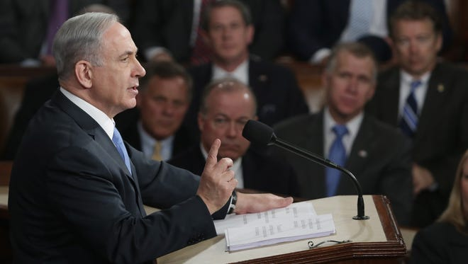 WASHINGTON, DC -   Israeli Prime Minister Benjamin Netanyahu speaks about Iran during a joint meeting of the United States Congress in the House chamber at the U.S. Capitol March 3, 2015 in Washington, DC. At the risk of further straining the relationship between Israel and the Obama Administration, Netanyahu warned members of Congress against what he considers an ill-advised nuclear deal with Iran.