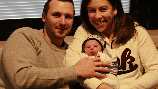 Brian McKenna and wife Allyson, hold their son Colin, the first baby born in Hunterdon County in 2016.