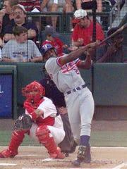 Montreal Expos' Vladimir Guerrero bats in the first