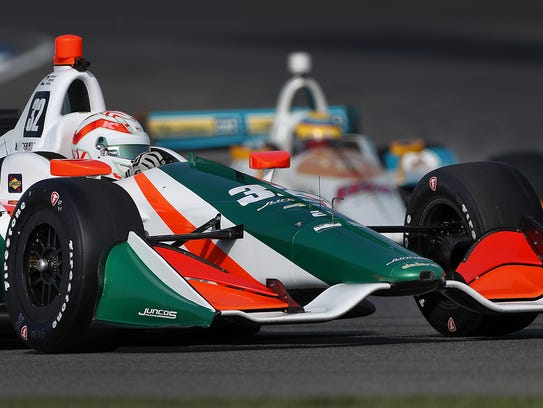 Juncos Racing's Kyle Kaiser (32) rounds turn two during