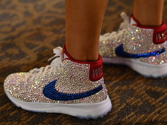 The shoes of Michelle Wie of Team USA are seen during a photocall prior to The Solheim Cup at the Des Moines Country Club on August 15, 2017 in West Des Moines, Iowa.