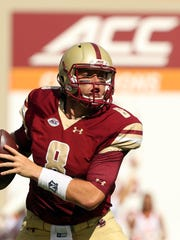 Boston College quarterback Patrick Towles (8) looks to pass during the first half of an NCAA football game against Boston College in Blacksburg Va. Saturday Sept. 17, 2016. (Matt Gentry/The Roanoke Times via AP)