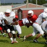 Pine Forest High School players run through plays Wednesday as they prepare for the fall season.