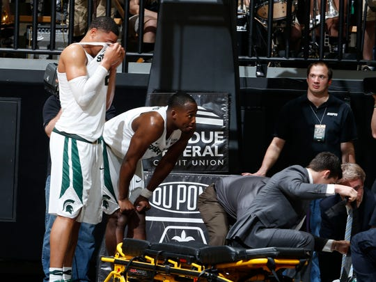 Michigan State Spartans forward Miles Bridges (22) wipes the tears from his eyes as guard Eron Harris (14) waits to be taken out on a stretcher during a game against the Purdue Boilermakers at Mackey Arena. Purdue defeats Michigan State 80-63.