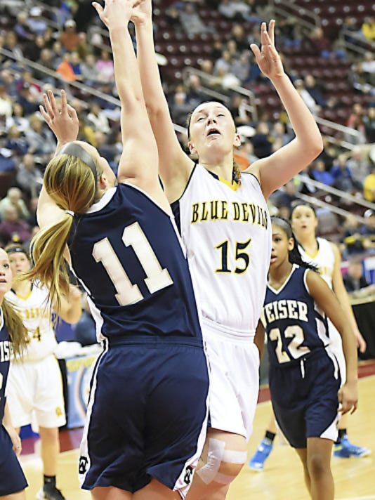 Katie Gelsinger (15) of Greencastle goes up for a shot against Conrad Weiser's Gwyneth Price (11) during the District 3, Class AAA girls Basketball Championship on Saturday. Gelsinger has been the Blue Devils' anchor this season despite a dip in scoring.