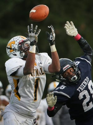 Tatnall wide receiver Cameron Easton eyes the ball while being defended by Friends senior Devonte Church before taking it 49 yards for a touchdown.