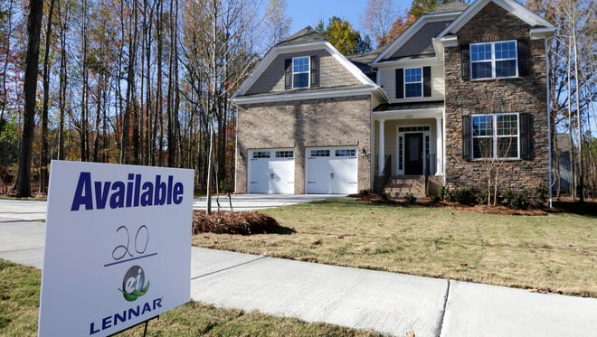 A home is advertised for sale in Matthews, N.C.  Private data provider CoreLogic reports rising home values have reduced the number of homes with underwater mortgages reports by 40% from a year ago.