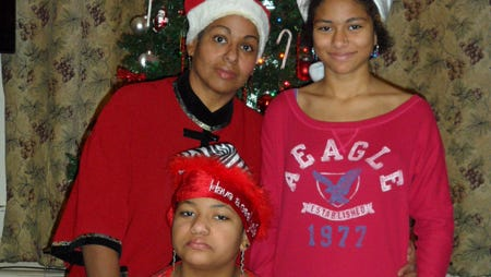 Zeyna Ahmed, with daughters Nadyah Abdul-Majid, 13, Hadyah Abdul-Majid, 11, during Christmas.