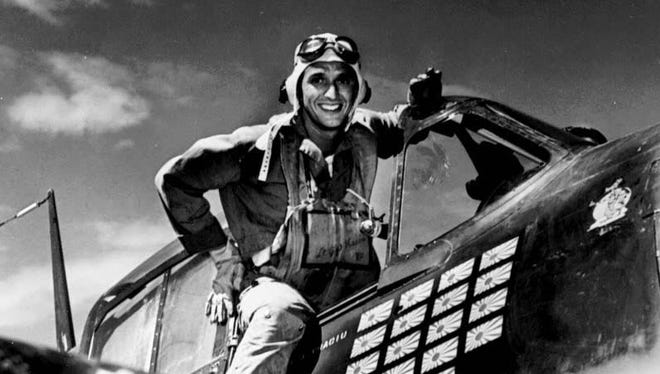 "Lt. Alexander Vraciu in his F6F after the ""Mission Beyond Darkness,"" Battle of the Philippine Sea, June 20, 1944."