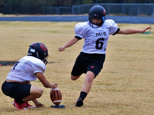 Strawn senior placekicker K-Lani Nava boots a practice field goal from 40 yards out on Wednesday in Strawn