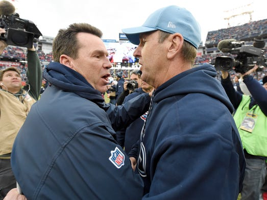 Broncos head coach Gary Kubiak and Titans head coach