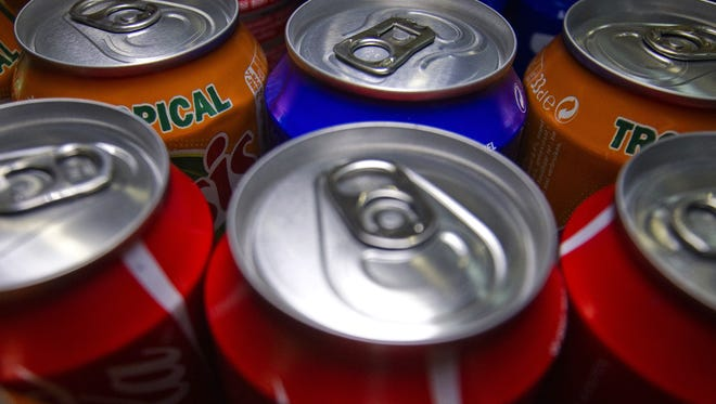 Cans of various soda.