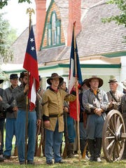 Fort Stanton reenactment soldiers stand at the ready to reenact an 1870s battle during Fort Stanton LIVE 2016.