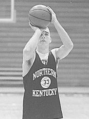Paul Cluxton shoots a free throw in practice in 1997.