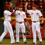 (Left to right) Reds left fielder Roger Bernadina, center fielder Chris Heisey and right fielder Jay Bruce celebrate a win against the Brewers at GABP on May 1.
