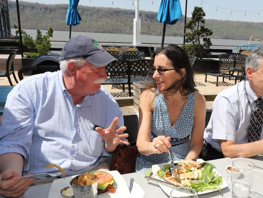 Bob Walters, left, one of the organizers chats with Jeanne Muchnick, the food and dining reporter for The Journal News and lohud.com as the Yonkers lunch group that meets every Thursday, sit down for their meal at Dolphin restaurant on the Yonkers waterfront, May 3, 2018.