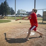Eli Moore of Appleton, Wis., takes a swing during a visit to the Field of Dreams near Dyersville, Iowa.