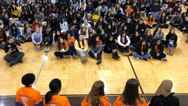 Students at North Farmington High School participate in National School Walkout Day on March 14, 2018.