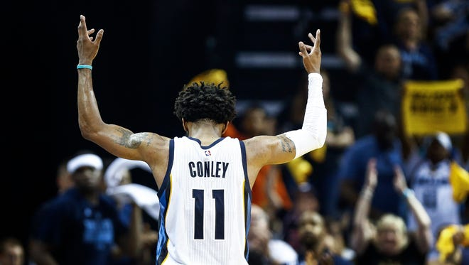 Memphis Grizzlies guard Mike Conley celebrates during Game 3 in the first-round series on April 20, 2017, at FedExForum.