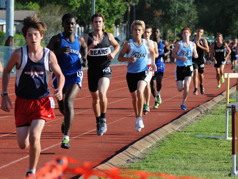 Boys run in an 800m race last track & field season.