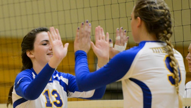 Abby Zackel and Sam Bitner of Titusville celebrate a point during a recent match against Viera.