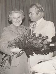 Gov. Edwin Edwards presented Virginia Shehee with flowers in November 1977.