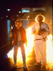 "Marty McFly (Michael J. Fox) and Dr. Emmett ""Doc"" Brown (Christopher Lloyd) in 1985's ""Back to the Future."""