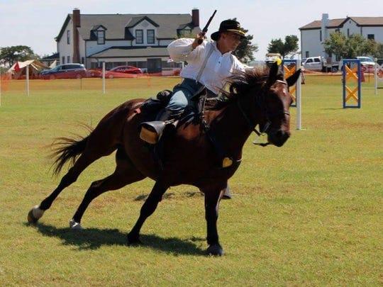Army Specialist Sam Ruzga, 23, competes in Civil War-era cavalry exercises.