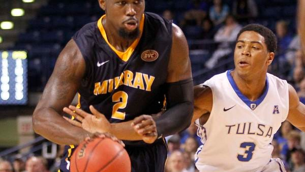 Murray State's Jonathan Fairell (2) drives past Tulsa's Shaquille Harrison in the first half of an NCAA college basketball game during the National Invitation Tournament, Monday, March 23, 2015, in Tulsa, Okla.
