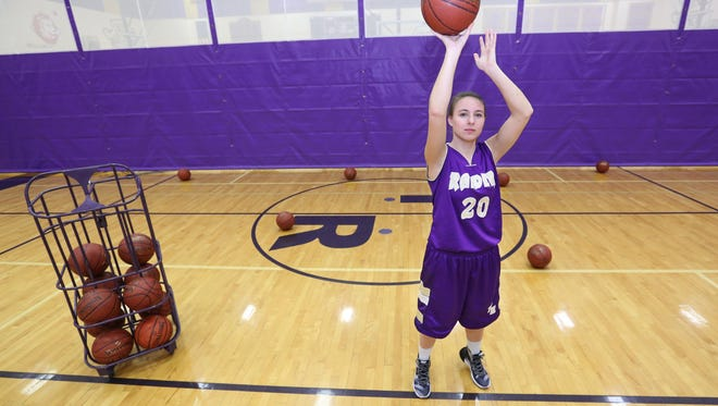 Two Rivers senior point guard Alexi Walesh poses for a senior spotlight portrait Wednesday in Two Rivers.