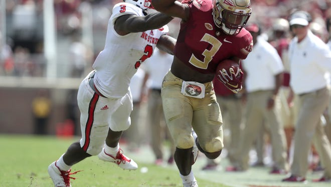 FSU's Cam Akers is pushed out of bounds near the goal line by NC State's Germaine Pratt during the Seminoles home opener at Doak Campbell Stadium on Saturday.