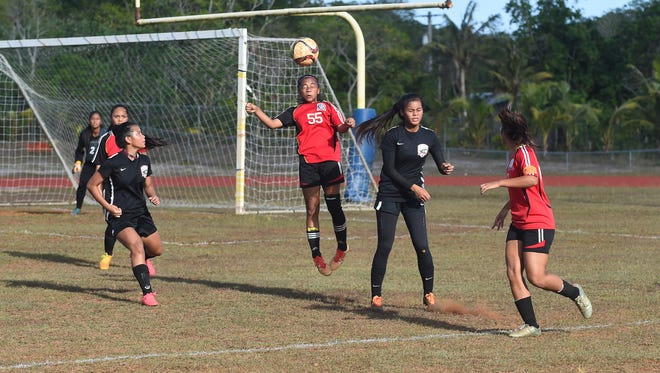 Okkodo High School player Richelle Ragadio (55) heads the ball against the Simon Sanchez Sharks during their Independent Interscholastic Athletic Association of Guam girls' soccer game at Okkodo High School in Dededo on May 16.