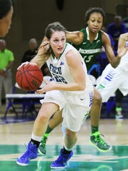 FGCU's Jenna Cobb drives to the basket against Jacksonville University recently at Alico Arena in Fort Myers.