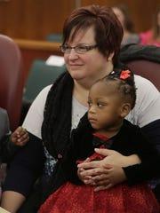 April DeBoer, 43, of Hazel Park, Mich., attends Michigan