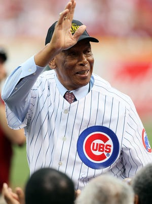 Ernie Banks waves to the crowd before throwing out a first pitch in 2010.