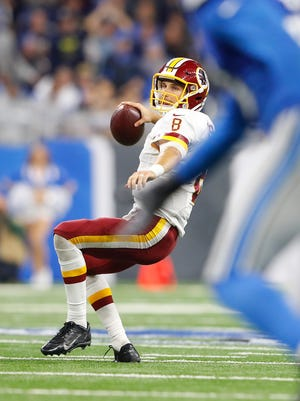 Kirk Cousins of the Washington Redskins drops back to pass late in the fourth quarter against the Detroit Lions on Oct. 23, 2016, in Detroit.