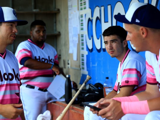 Hooks' batboy Noah Garcia (center) talks with players before the start of the game on Saturday, July 8, 2017, at Whataburger Field in Corpus Christi.