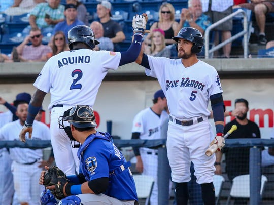 Pensacola's Aristides Aquino (2) gets a high five from Alex Blandino (5) after hitting a solo homerun against the Biloxi Shuckers on Monday, May 1, 2017.