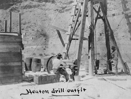 Miners operate the Heaton Drill, ca. 1905. Parts of
